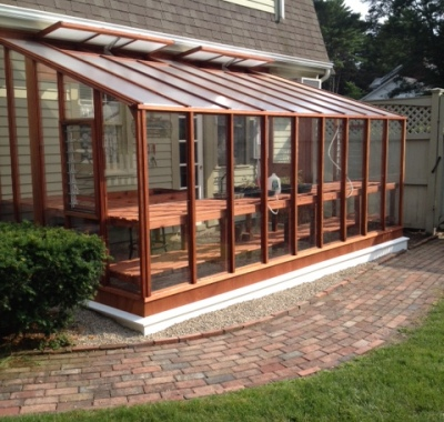 8 x 16 Deluxe Glass-to-Ground Lean-to tucked underneath ridge