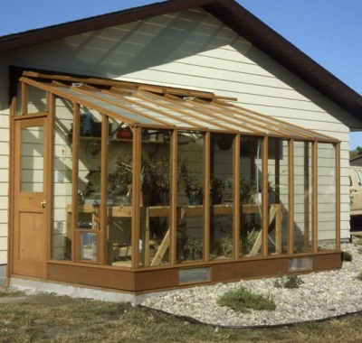 6 x 12 Deluxe Glass-to-Ground redwood greenhouse on Sturdi-Built base wall