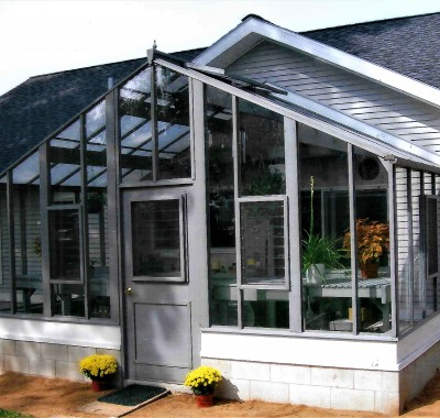 """Attached 16' x 9' Deluxe Glass-to-Ground with Jalousie Windows in door and in end wall on 18"""" high block wall"""