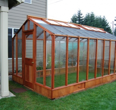 Door end view of 9x16 Deluxe Glass-to-Ground with Standard door on Sturdi-Built base wall