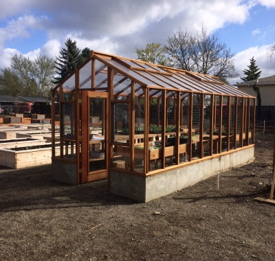 """9x20 Deluxe Glass-to-Ground with two jalousie windows and Full Lite door on 18"""" high concrete base wall"""