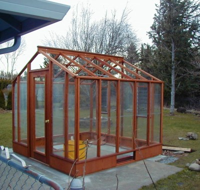 """9x9 Deluxe Glass-to-Ground with two jalousie windows in back end wall and Full Lite door on 9.5"""" high Sturdi-Built base wall"""