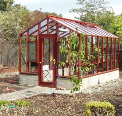 """Side view of 9x14 Deluxe Glass-to-Ground with two jalousie windows and Full Lite door on 18"""" high block base wall"""