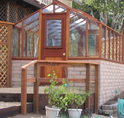 Traditional greenhouse on block wall