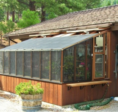 8x14 Deluxe Regular Lean-to tucked underneath eave with shade cloth on roof and walls