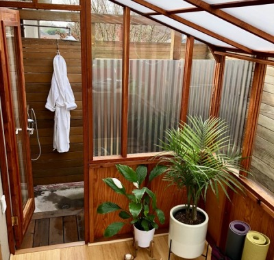 6x9 Deluxe Regular Lean-to with White Twin Wall Thermal Option used as a yoga studio