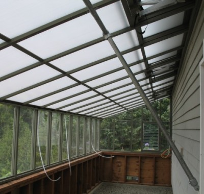 Interior of 8x24 Deluxe Regular Lean-to with White Twin Wall Thermal Option and pipe bracing for roof support