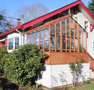 Corner view of custom 11x10 Garden Deluxe with door in side wall