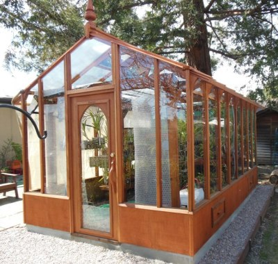 Glass greenhouse with orchids in San Jose CA