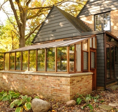 8x14 Garden Sunroom with jalousie windows for added ventilation set on a brick base wall to match home
