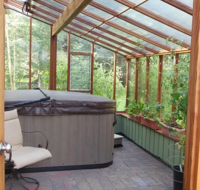 Interior of 9x18 Garden Sunroom greenhouse with hot tub