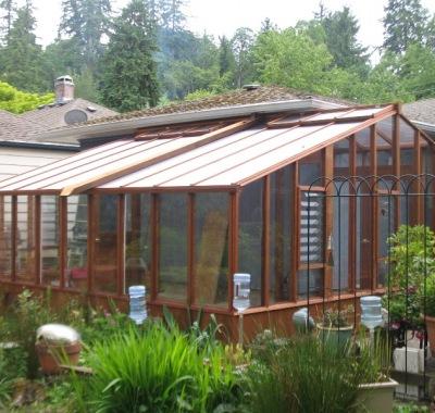 Custom sized garden sunroom built around a corner of a house