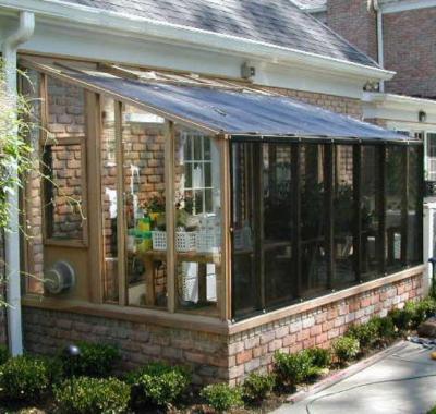 Garden sun room greenhouse with shade cloth
