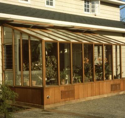 Garden Sunroom greenhouse built under the eave