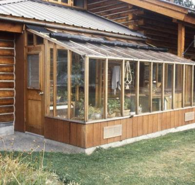 8x16 Garden Sunroom greenhouse attached to a log cabin