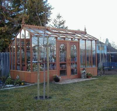 Tall redwood and glass greenhouse