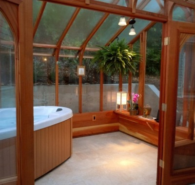 Interior of greenhouse with hot tub