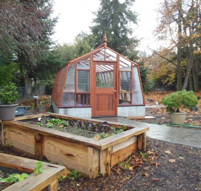 Redwood greenhouse with concrete base wall