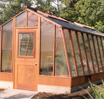 11x20 Solite redwood greenhouse with Jalousie window in the door and shade cloth on the roof