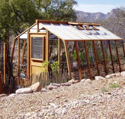 Home greenhouse in desert with jalousie window