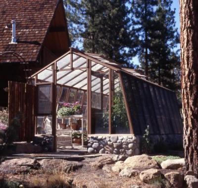"""11ft wide Solite redwood greenhouse set on 18"""" rounded stone base wall"""