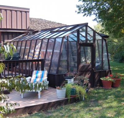 11ft wide Solite home greenhouse with one end attached to the house