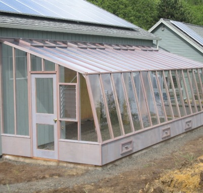 Large lean-to greenhouse attached to a barn