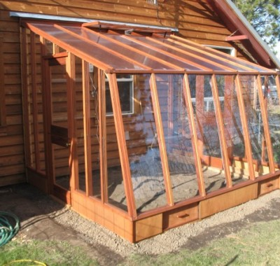 """9 1/2' x  11' Solite Lean-to with doors at both ends  on 9.5"""" Sturdi-Built base wall"""