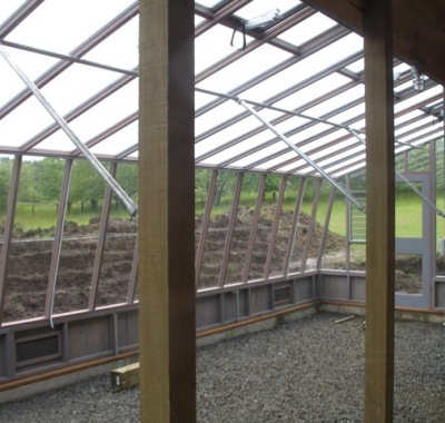 Interior of the 9x30 Solite Lean-to greenhouse with pipe beams and braces for roof support