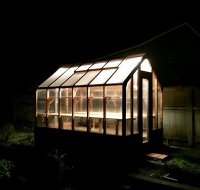 7x11 Trillium exterior at night with grow lighting