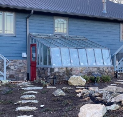 9x12 Tropic Lean-to greenhouse with stone base wall