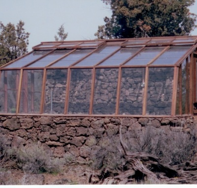 Lava rock base wall lean-to greenhouse