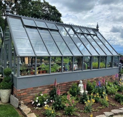 Side view of 10x18 Tudor greenhouse with beautiful view overlooking Willamette Valley, OR