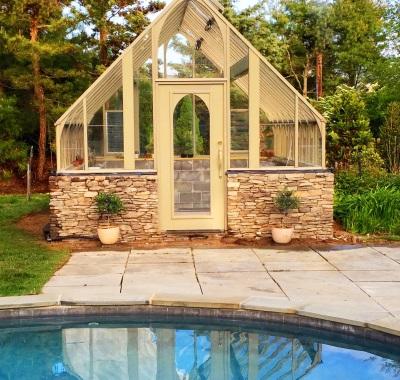 Tudor style painted greenhouse with stone base