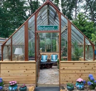 12x16 Tudor greenhouse on wood base wall