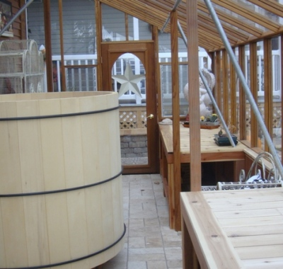 Lean-to greenhouse with hot tub